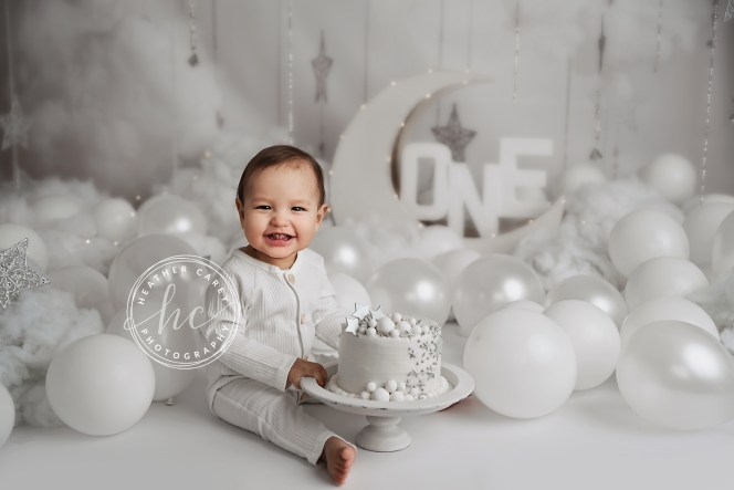 Heaven themed photo backdrop with moon and stars.