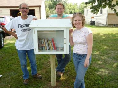 From left to right: My dad, who built and installed the library, my husband, and me.