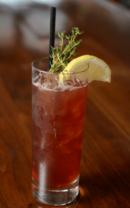 a cocktail with lemon and rosemary