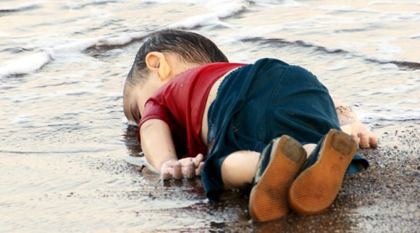 Aylan, 3, lying dead on a Turkish beach. Photo: Reuters