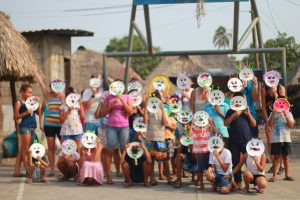 Children posing with masks