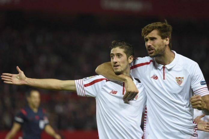 Escudero celebra el gol junto a Llorente   Imagen: Sevilla FC
