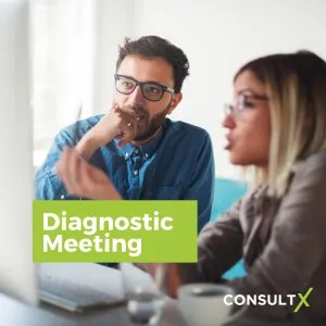 "Woman and man look at a laptop with ""Diagnostic Meeting"" title"