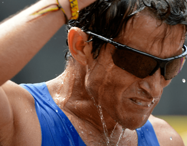 Aug 12, 2012; London, United Kingdom; Juan Carlos Cardona (COL) pours water on his head after competing in the men's marathon during the London 2012 Olympic Games at The Mall. Mandatory Credit: Leo Mason-USA TODAY Sports