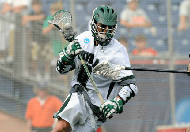 May 26, 2012; Boston, MA, USA; Notre Dame Fighting Irish defense Stephen O'Hara (4) and Loyola Maryland Greyhounds attack Mike Sawyer (4) during the second half of the NCAA Division I semifinals at Gillette Stadium. Mandatory Credit: Bob DeChiara-US PRESSWIRE