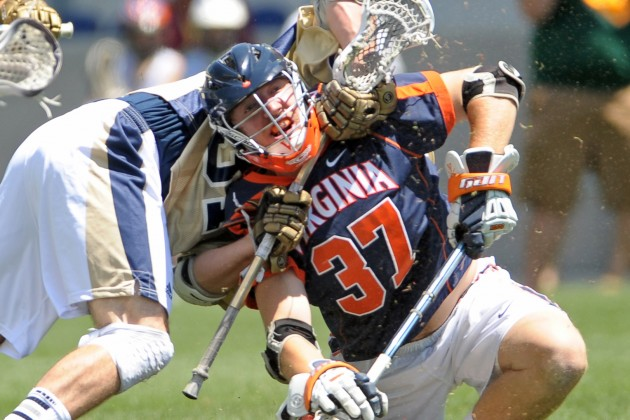 May 20, 2012; Chester, PA USA; Note Dame Fighting Irish midfielder Liam O'Conner (31) takes down Virginia Cavaliers midfielder Ryan Benincasa (37) after a face-off during the 1st half of the NCAA Division I Men's Lacrosse Quarterfinals at PPL Park in Chester. Mandatory Credit: Eric Hartline-USA TODAY Sports