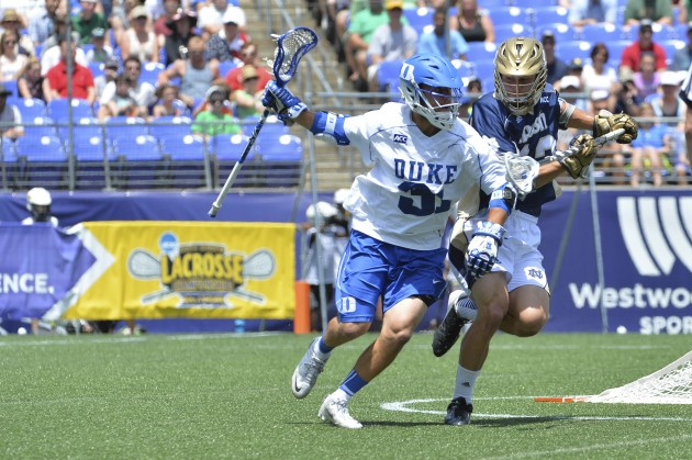 May 26, 2014; Baltimore, MD, USA; Duke attack Jordan Wolf (31) drives to the net as Notre Dame midfielder Tyler Brenneman (13) defends in the first quarter of the men's NCAA Lacrosse Championship game at M&T Bank Stadium. Mandatory Credit: Tommy Gilligan-USA TODAY Sports