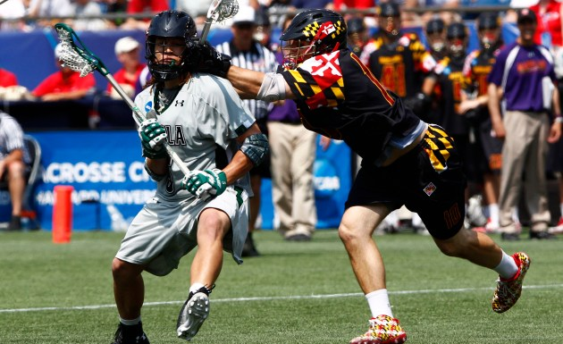 May 28, 2012; Foxborough, MA, USA; Loyola Greyhounds midfielder Josh Hawkins (left) is checked by Maryland Terrapins midfield Michael Shakespeare (10) during the second half of the NCAA Division I Men's Lacrosse National Championship at Gillette Stadium. Mandatory Credit: Mark L. Baer-USA TODAY Sports
