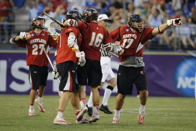 May 28, 2011; Baltimore, MD, USA; Maryland Terrapins midfield Brian Farrell (37) points to his bench while celebrating a goal with teammates during the second half of the NCAA Division I Men's Lacrosse semifinal at M&T Bank Stadium. Mandatory Credit: Rafael Suanes-USA TODAY Sports