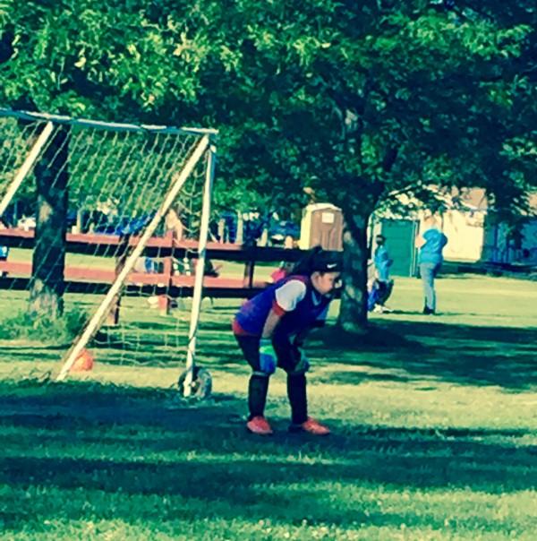 Jordyn playing in net for her soccer team