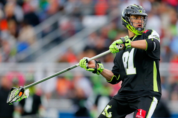 HEMPSTEAD, NY - APRIL 27:  Kyle Hartzell #81 of the Long Island Lizards in action against the Rochester Rattlers at James M. Shuart Stadium on April 27, 2014 in Hempstead, New York. Lizards defeated the Rattlers 18-15.  (Photo by Mike Stobe/Getty Images)