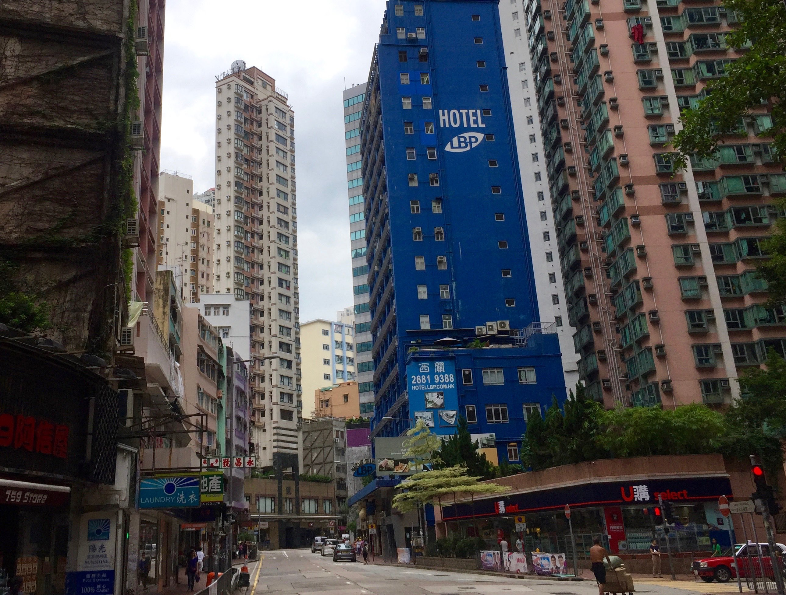 Hong Kong Queen's Road West linking Sheung Wan from Queen's Road Central easy access to foodie traffic