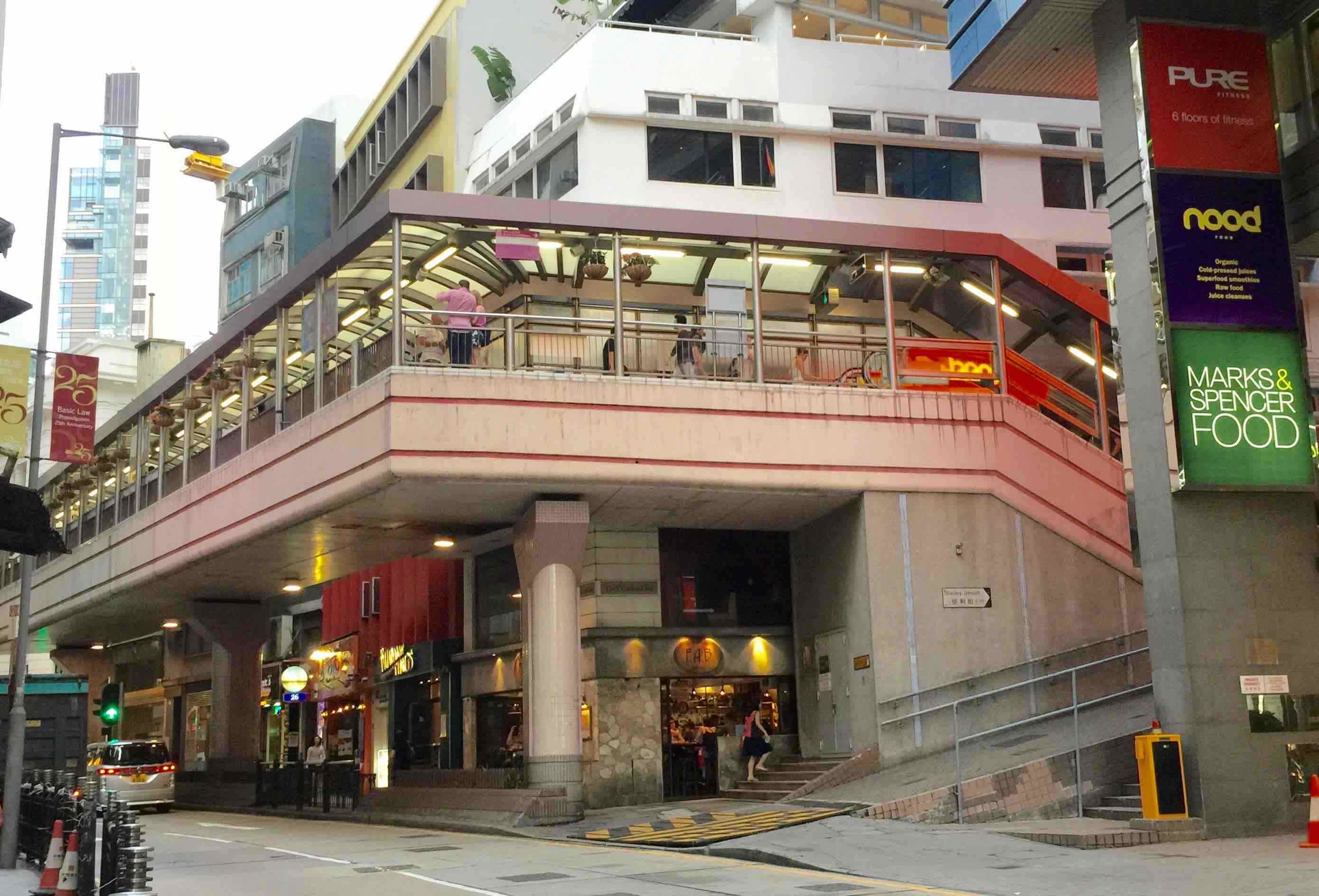 Soho escalator Central Hong Kong key foodie traffic connection