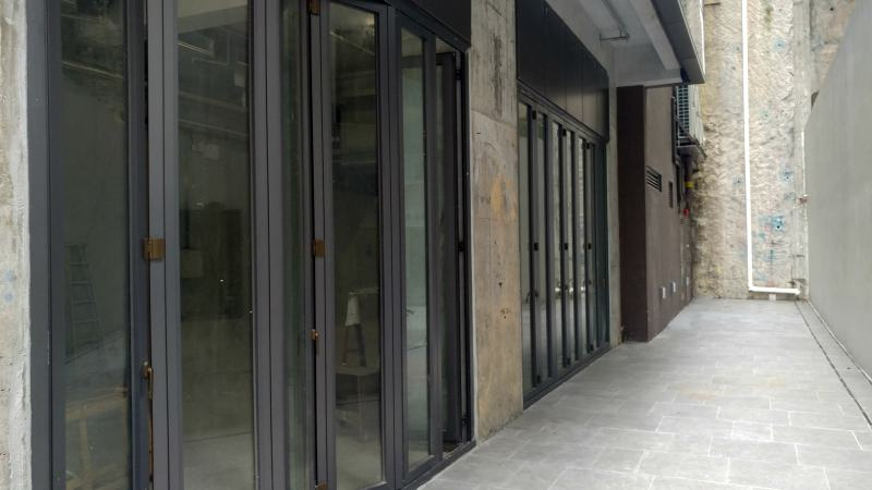 Sliding-open door in FBs space to let in Hillwood Road, Tsim Sha Tsui, Hong Kong