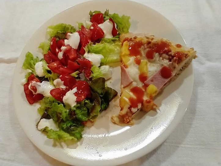 One serving of rising crust pizza with a salad on the side.