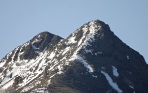 Over the years, many folks have climbed Squaw Mountain, as shown by these cairns, captured by our new telephoto lens.