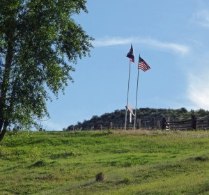 Flags marking the state line at the Home Ranch headquarters