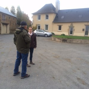 Pat with Julia in front of their 400-year-old farmhouse
