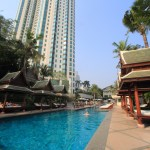 At the Peninsula Bangkok urban resort swimming pool swim, soak up the Sun