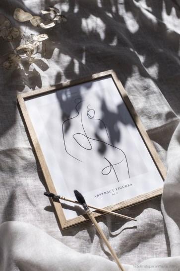 Des affiches Desenio en line art corps femme