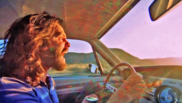 Karl-Ludwig Poggemann - dazzled maniac Jim Morrison drowns out the haunting whimper of a coyote dying on the road by his dreadful death-scream into the abyssal sun - Flickr - La Déviation