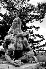 A dark statue behind Trent Park manor