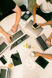 photo of people using laptop