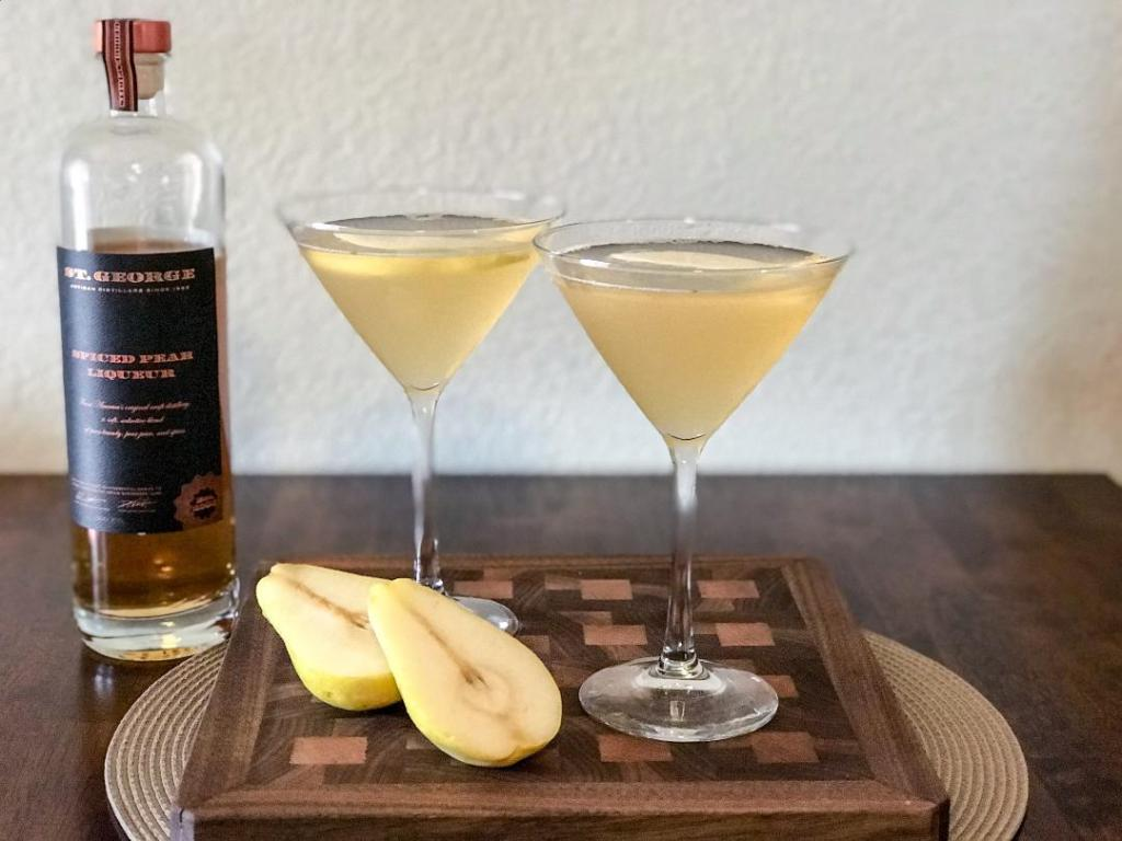 Essence of fall martini made with St. George Spiced Pear Liqueur, Vodka, Lemon Juice, Simple Syrup, andfresh pears and cinnamon stick for garnish