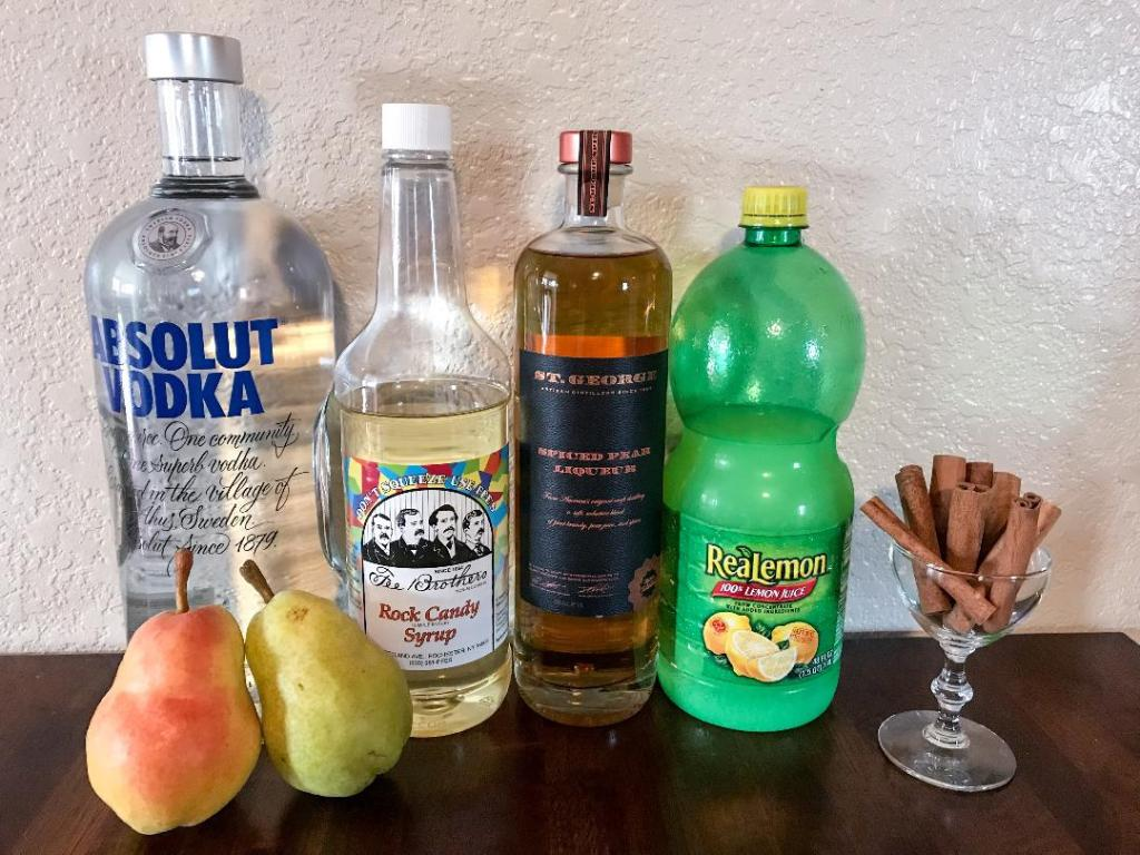 Essence of Fall Martini with ingredients of Vodka, St. George's Spiced Pear Liqueur, Simple Syrup, and Lemon Juice. Part of the series we call Thank Goodness It's Martini Friday