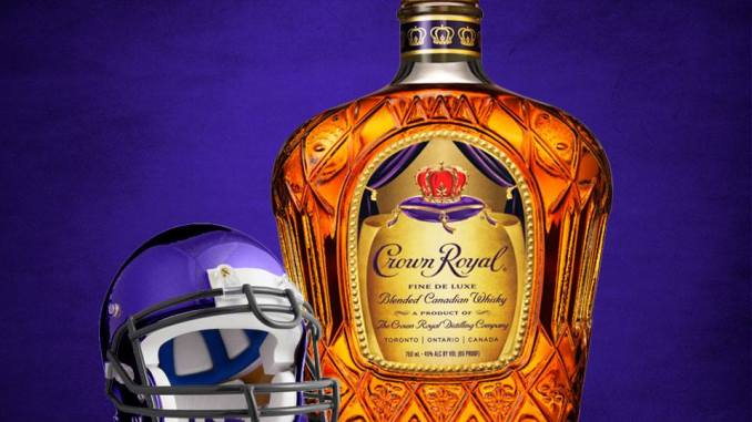 A bottle of Crown Royal Whisky and purple football helmet