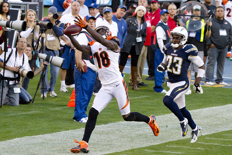 NFL Cincinnati Bengals wide receiver A.J. Green trying to catch a football pass against the Los Angeles Chargers defense