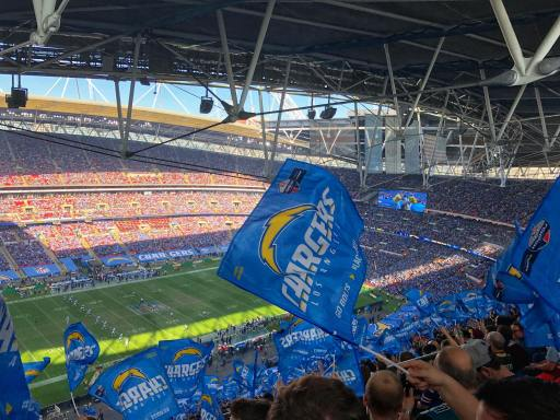 Los Angeles Chargers stadium during a game with hundreds of blue Chargers flags waving in the air.