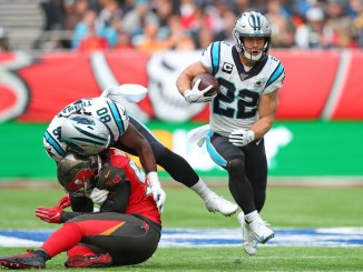 NFL Carolina Panthers running back Christian McCaffrey running for a touchdown.