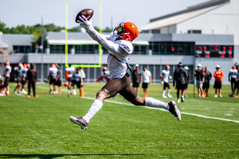 NFL Cleveland Browns Wide Receiver Odell Beckham Jr. leaping to catch a pass in training camp practice.