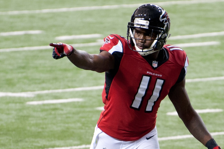 NFL Atlanta Falcons Wide Receiver Julio Jones on the football field pointing to the fans