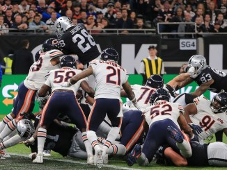 NFL Las Vegas Raiders running back Josh Jacobs jumping over the pile to score a touchdown at the goal line against the Chicago Bears