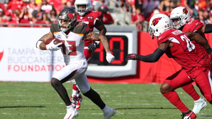 NFL Tampa Bay wide receiver Mike Evans running with the football after catching a pass against the Arizona Cardinals