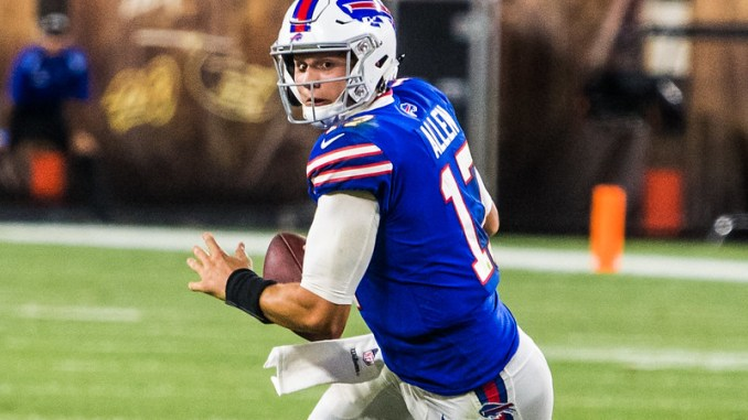 NFL Buffalo Bills quarterback Josh Allen getting ready to throw a pass on the football field