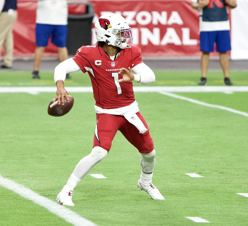 NFL Arizona Cardinals quarterback Kyler Murray attempting a pass in a football game.