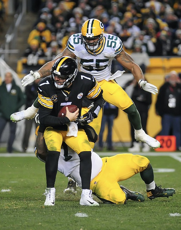 NFL Green Bay Packers defense sacking Pittsburgh Steelers quarterback Ben Roethlisberger in a football game.