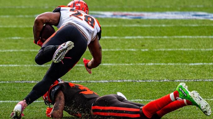 NFL Cincinnati Bengals running back Joe Mixon running back running over a Cleveland Browns defender