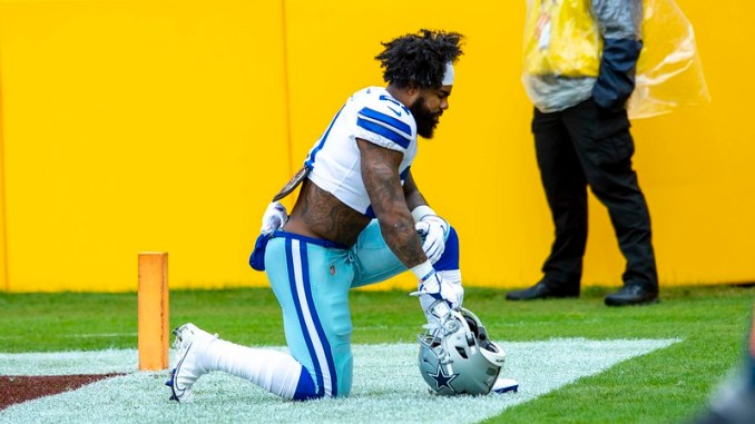 Dallas Cowboys running back Ezekial Elliott taking a knee