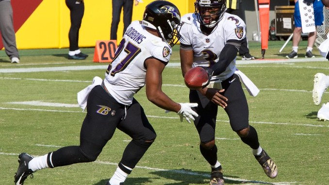 NFL Baltimore Ravens running back J.K. Dobbins taking a handoff from quarterback RG3