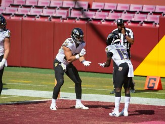 Baltimore Ravens tight end Mark Andrews doing a touchdown dance with teammate wide receiver Marquise Brown