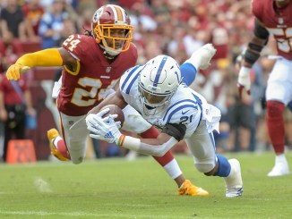 NFL Indianapolis Colts running back Nyheim Hines diving for a touchdown against the Washington Football Team