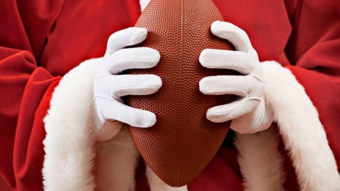 Santa holding a football