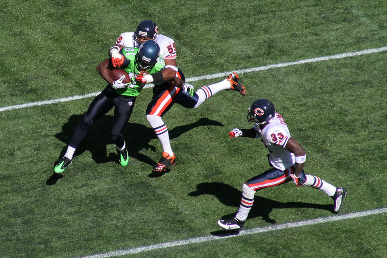 The Chicago Bears defense tackling a Seattle Seahawks player.