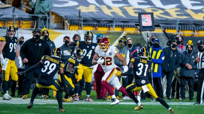 Washington Football Team tight end Logan Thomas running after the catch against Pittsburgh Steelers defenders.