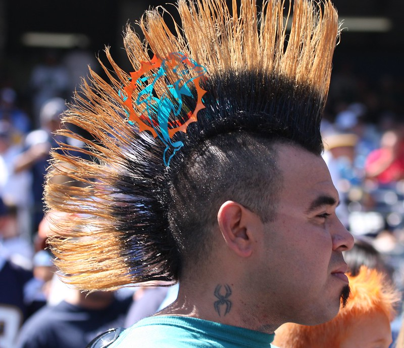 A Miami Dolphins fan with a Miami Dolphins logo in his mohawk.