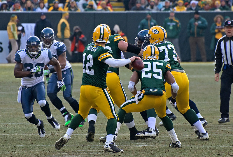 Green Bay Packers quarterback Aaron Rodgers throwing a pass in a football game.